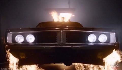 Not using a motorcycle anymore, but a car. A BURNING CAR!
